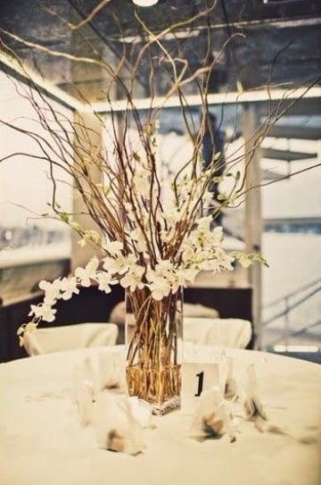 centros de mesa con ramas para bodas