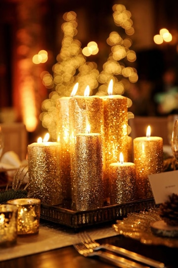 centros de mesa dorados con velas