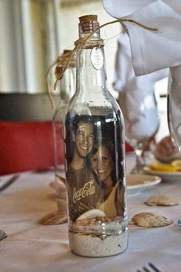 centros de mesa con fotos en botella
