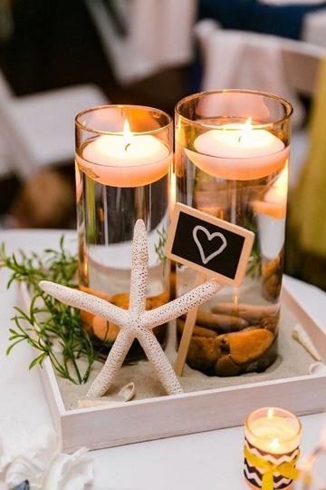 centros de mesa para boda en la playa con velas