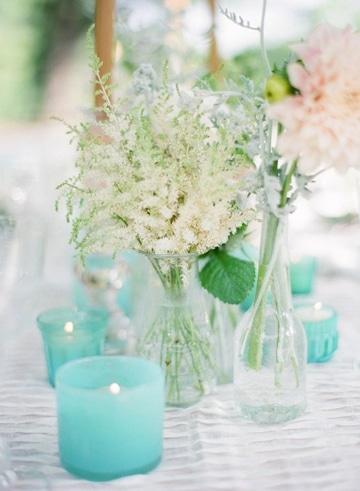 centros de mesa azul turquesa con velas