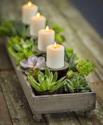 macetas de centro de mesa con velas