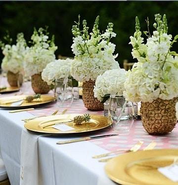 centros de mesa con piñas para bodas