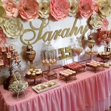 mesa de dulces para quince años color rosa
