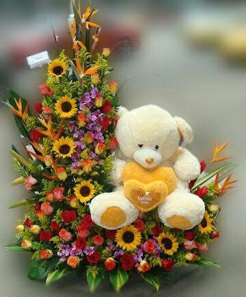 arreglos florales con peluches amarillo