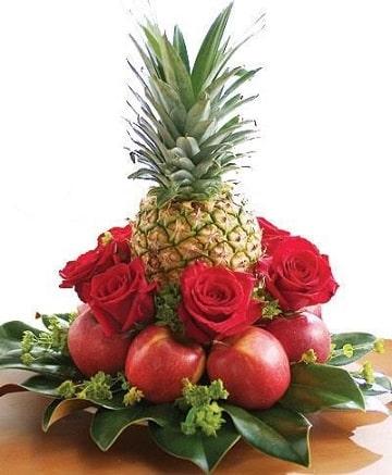 arreglos florales tropicales con frutas