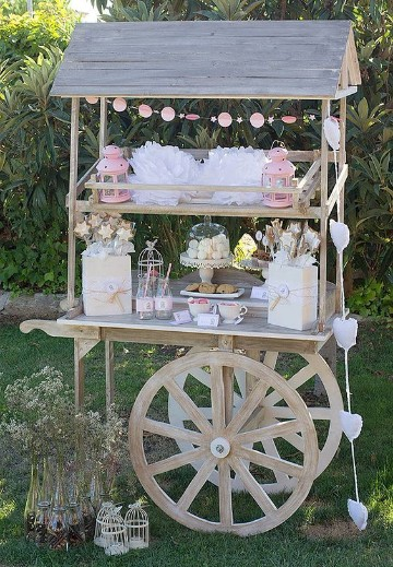 mesa de dulces para bautizo vintage carruaje