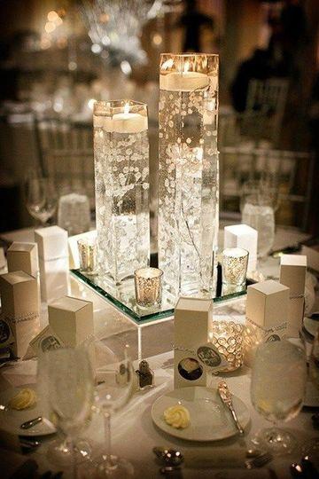centros de mesa con espejos y velas