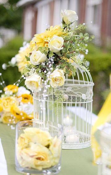 centros de mesa florales para boda en jaulas