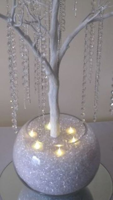 centro de mesa luminoso con velas sumergibles