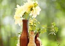 Originales estilos con arreglos de mesa con botellas