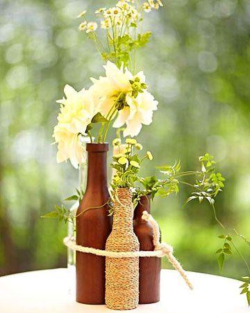 arreglos de mesa con botellas rusticos