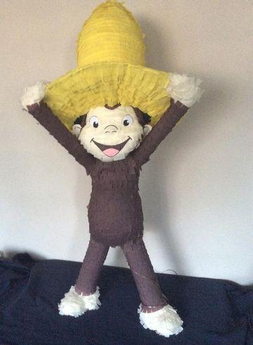 piñata de jorge el curioso con sombrero