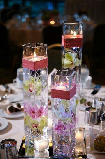 centros de mesa con vidrio y velas para 15 años