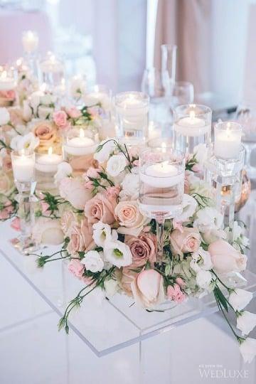 centros de mesa con vidrio y velas para boda