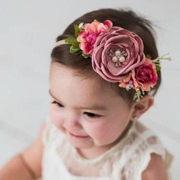 modelos de diademas de flores para bebes