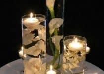 Elegantes adornos con velas para centro de mesa