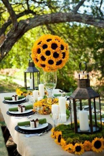 centros de mesa con girasoles para boda