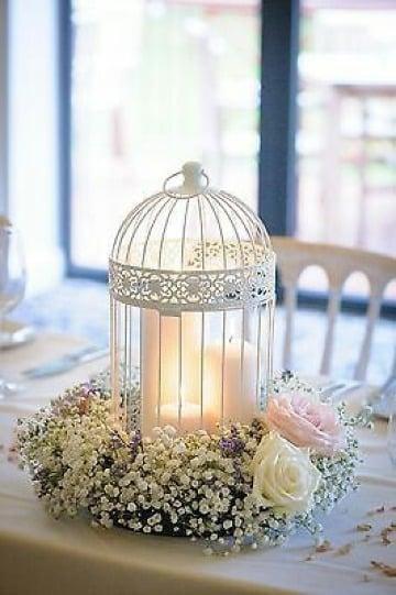 centros de mesa con jaulas y velas