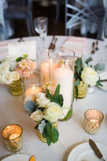 centros de mesa boda con velas altas