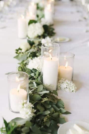 centros de mesa con eucalipto y velas
