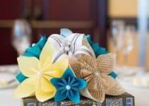 4 hermosas mesas decoradas con flores de papel