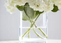 4 flores blancas para centro de mesa de bodas