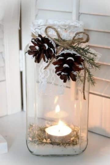 centro de mesa con arpillera con velas