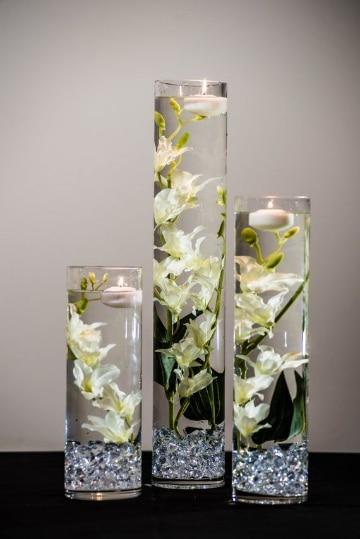 centros de mesa con velas flotantes grandes
