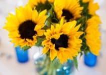 4 estilos de centros de mesa de girasoles para boda