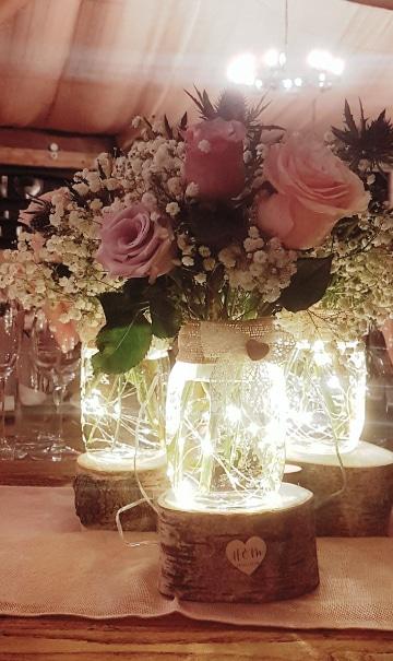 centro de mesa con frascos para 15 con luces