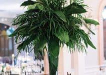 4 estilos centros de mesa con hojas verdes para fiestas