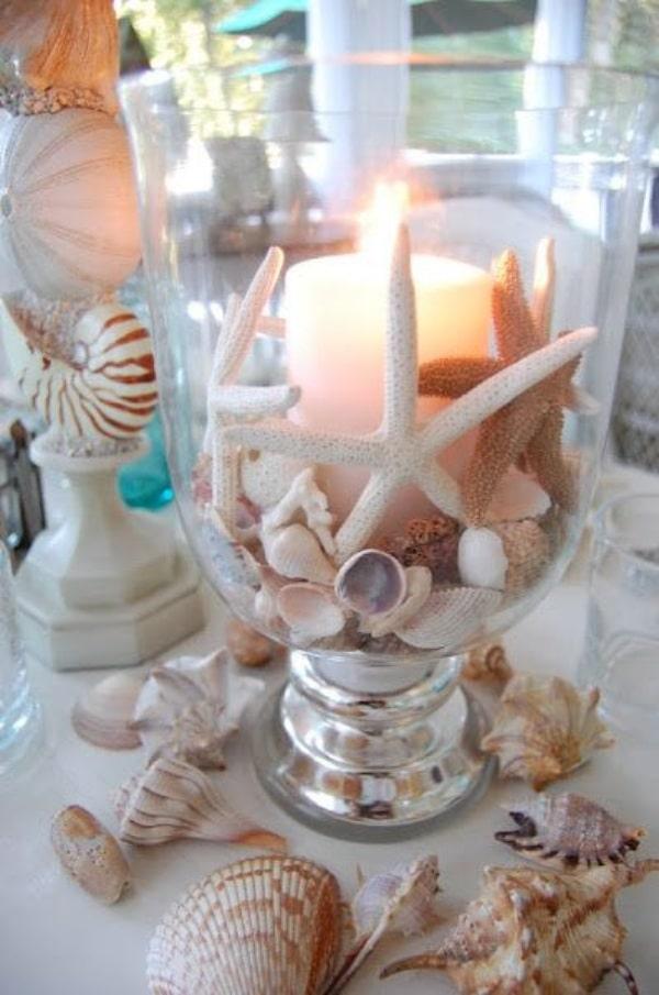 centro de mesa con caracoles para bodas