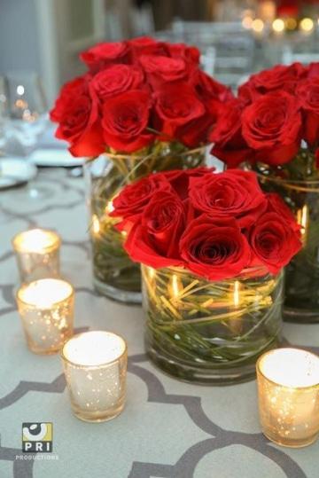 centros de mesa con flores rojas para bodas