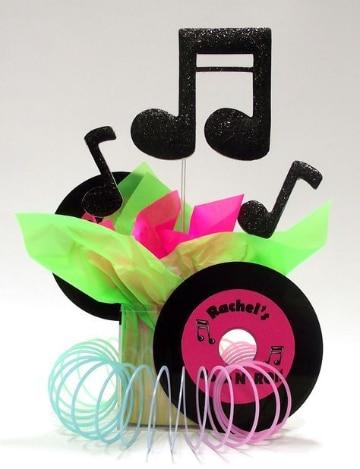 centros de mesa con notas musicales para quinceaños