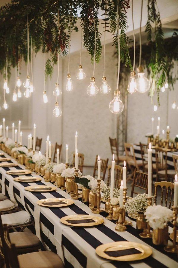 centro de mesa negro y dorado para matrimonios