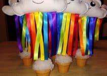 3 centros de mesa de arcoiris para fiestas infantiles